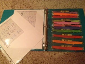 a project binder with pattern and floss inserts